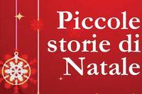 """scritta """"Piccole storie di Natale"""" su sfondo rosso con stelle di Natale"""