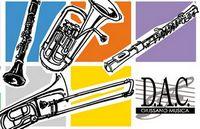 strumenti musicali disegnati su sfondo colorato e scritta D.A.C. Giussano Musica
