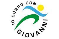 """logo dell'Associazione: persona stilizzata nell'atto del correre racchiusa in un cerchio con scritta """"Io corro con Giovanni"""""""