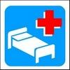 riproduzione stilizzata di un letto e una croce rossa