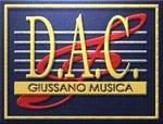 Il logo dell'associazione è un rettangolo di colore blu al centro le righe di uno spartito di colore bianco con sopra una chiave di violino di colore rosso. Sopra al tutto la scritta D.A.C. di colore giallo e all'interno di una striscia di colore giallo la scritta giussano musica di colore blu